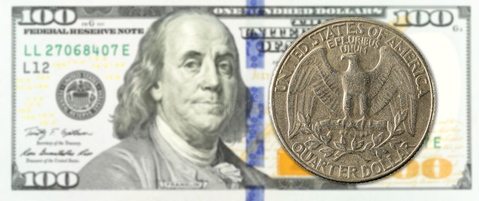 One quarter dollar coin against 100 us-dollar banknote obverse stock photos