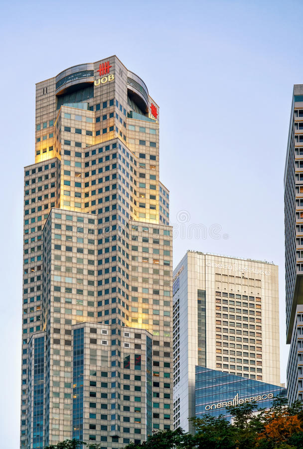One raffles place and uob plaza in singapore skyline editorial download one raffles place and uob plaza in singapore skyline editorial photography image of asia reheart Images
