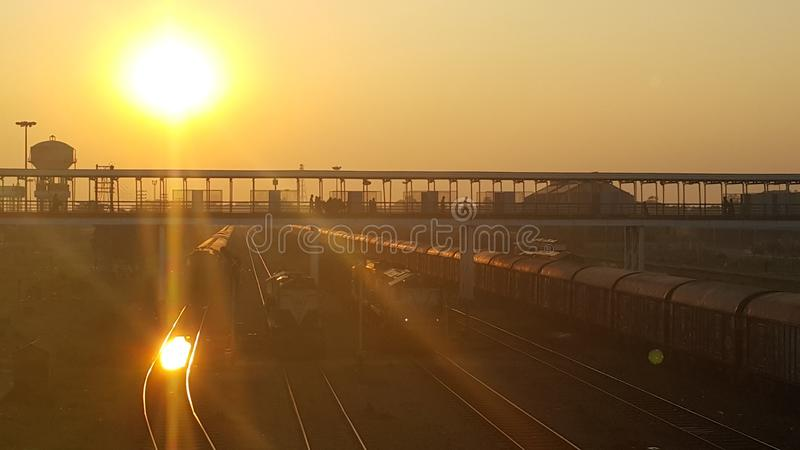 The One at the Railway Station. Kharagpur railway station. Natural golden hue. Reflection of the sun in the water on the tracks stock photo