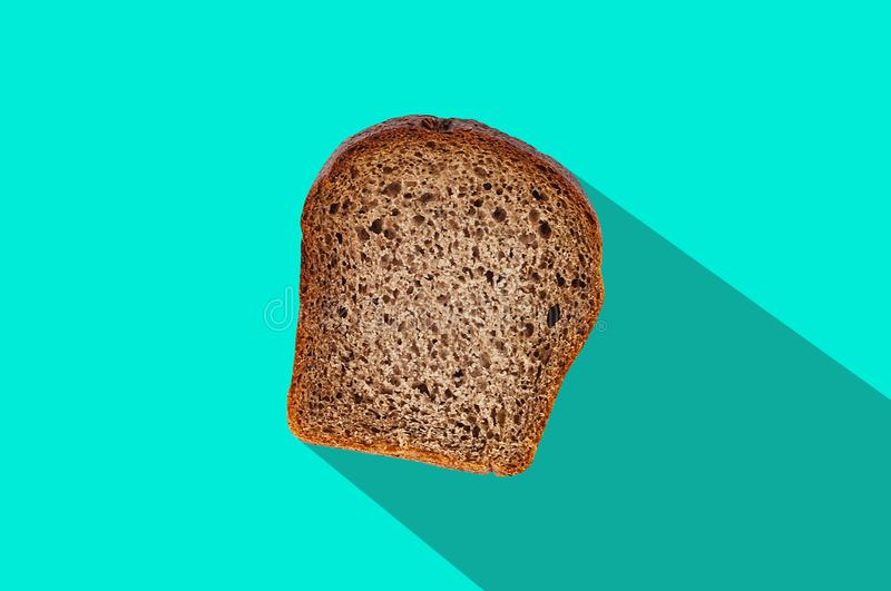 One rectangle piece of fresh rye bread in center of green table on kitchen with long hard shadow. Top view. Dieting concept royalty free stock photos
