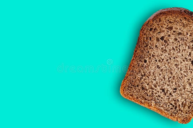 One rectangle piece of fresh rye bread on green table on kitchen. Copy space for your text. Top view. Dieting concept royalty free stock photos