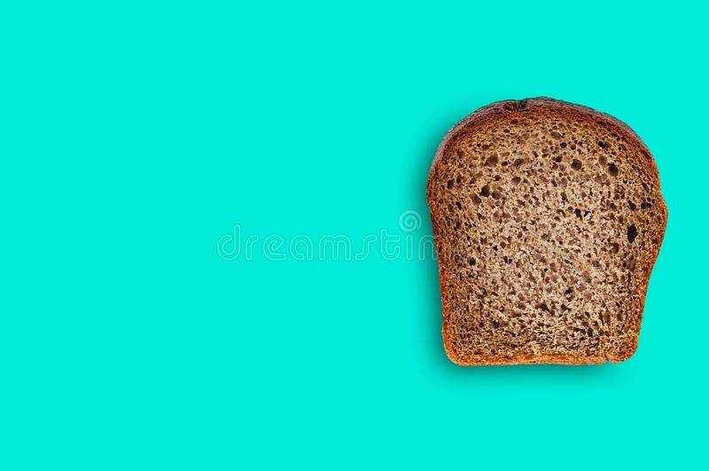 One rectangle piece of fresh rye bread on green table on kitchen. Copy space for your text. Top view. Dieting concept stock images