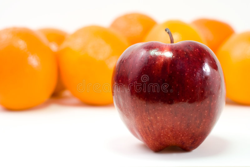 Download One Red Apple And Bunch Of Oranges Stock Photo - Image: 8264094