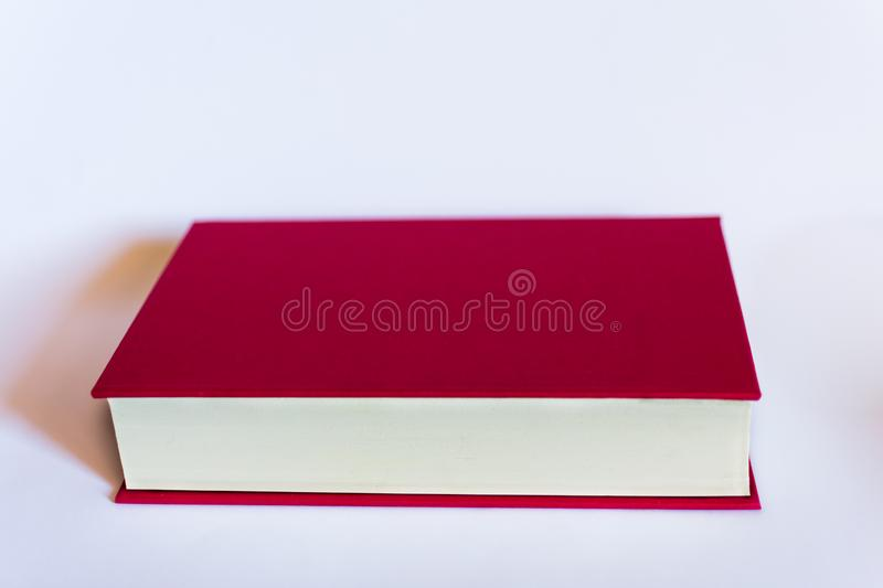 One red book close on white background. Concept, still live royalty free stock image