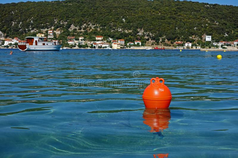 One red buoy. And a sea royalty free stock photos
