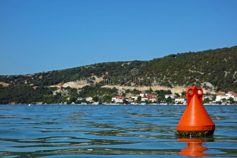 Red buoy and a sea. One red buoy and a sea royalty free stock photos