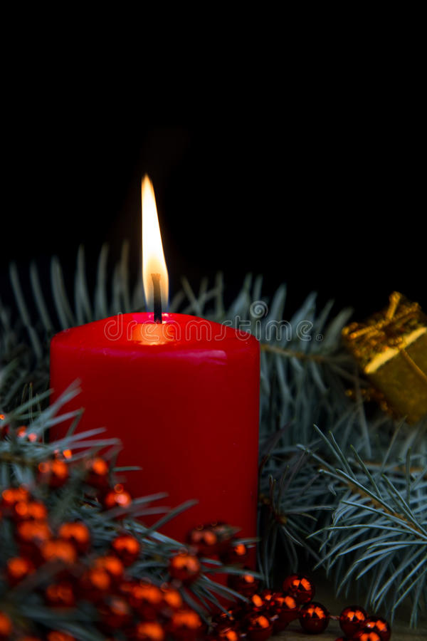 One red burning Christmas candles stock photos