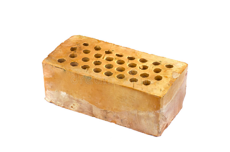 Download One Red Clay Brick With Holes Isolated Stock Photo
