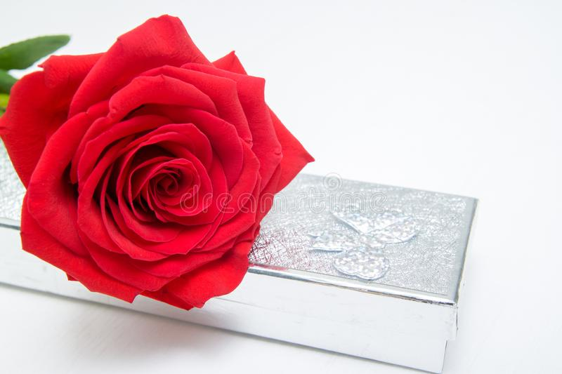 Red Rose and jewelery present box on white wooden Background. copy space - Valentines and 8 March Mother Womens Day concept royalty free stock photo
