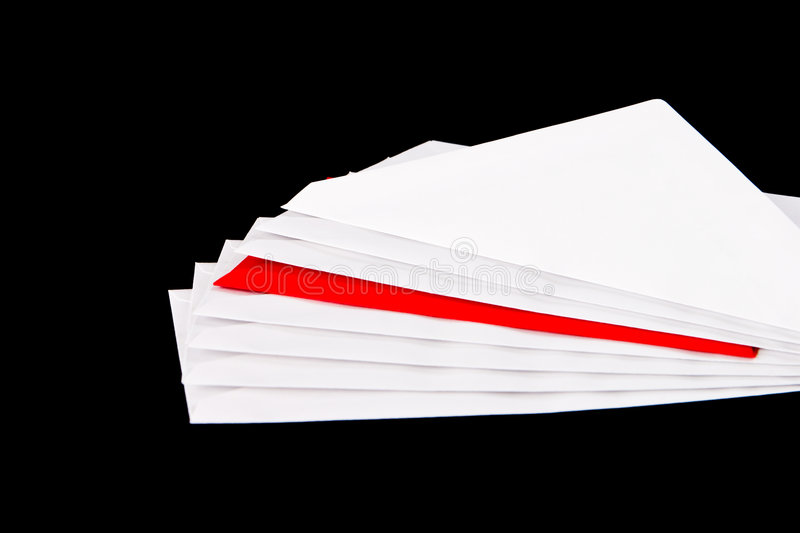 One Red and seven white envelopes royalty free stock image