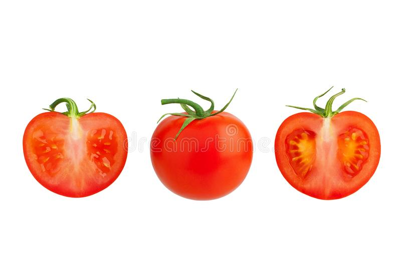 One red tomato with green leaves and two cut off tomatoes halves on white background isolated close up, whole and sliced tomatoes royalty free stock images