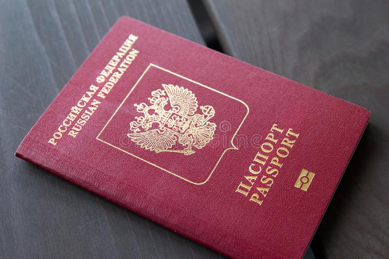 The one russian passport on wooden surface stock images
