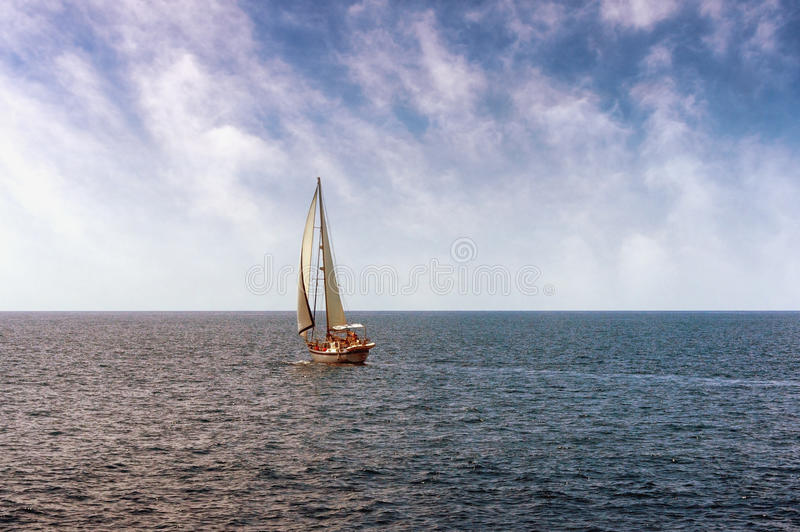 One sailing boat. In open sea royalty free stock photos
