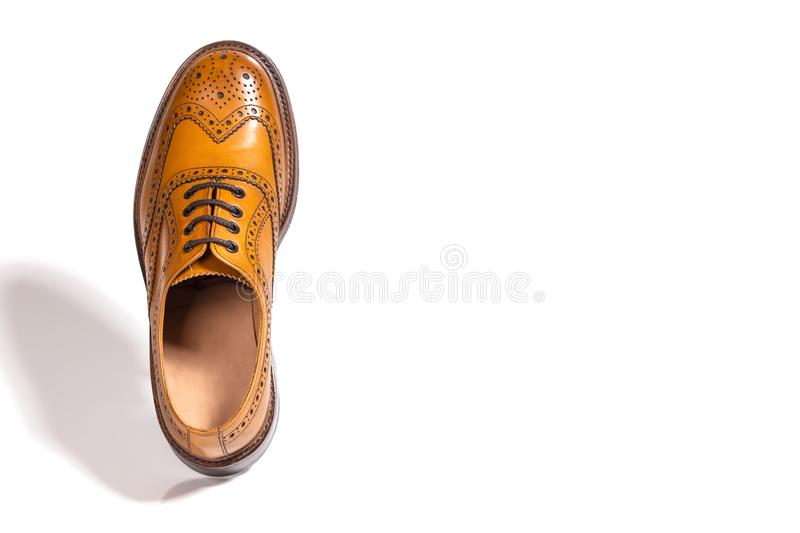 One Separate Male Tan Brogue Oxford Shoe. Isolated. Over White Background. Horizontal Image stock photos