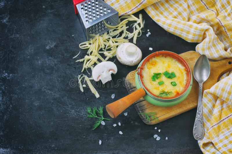 One serving baked julienne with mushrooms, onions and cheese stock images
