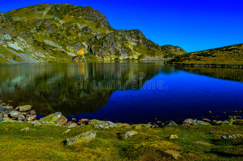 One of the the Seven Rila Lakes. Lake Kindey stock image