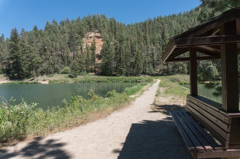 Fawn Lakes bench in northern New Mexico. One of several benches which are spread around the Fawn Lakes in northern New Mexico stock photos