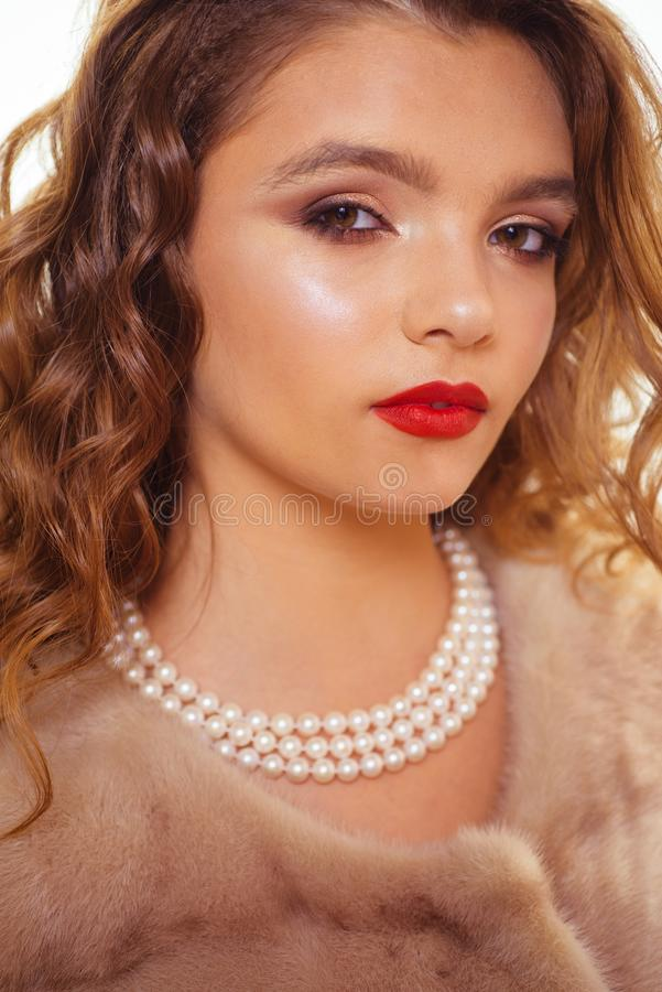 One shade of red. Young woman with red lips. Pretty girl with perfect skin and glamour makeup. Fashion model with glossy. Lip makeup. Beauty look of skincare stock photography