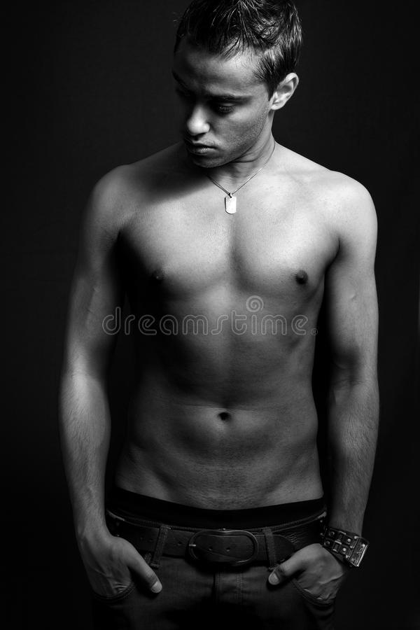 One shirtless masculine young man stock photo