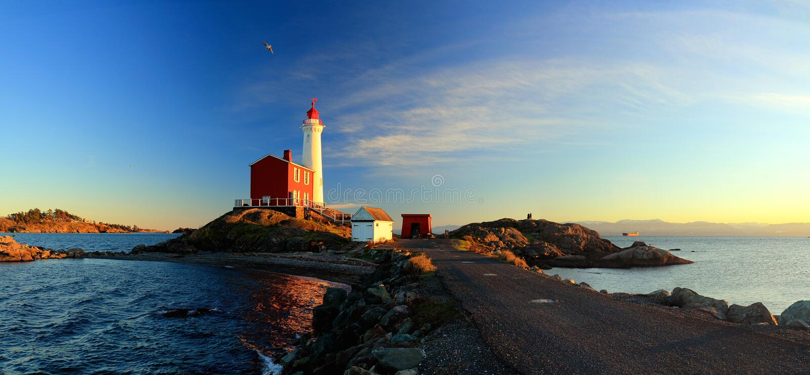 Landscape Panorama of Fisgard Lighthouse at Sunset, Fort Rodd Hill National Historic Site, Victoria, Vancouver Island, BC, Canada. Landscape panorama of Fisgard royalty free stock images