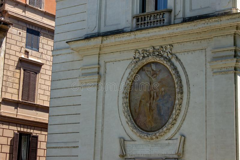 On one side of a building the picture of Christ on the cross. Rome Italy. 07/07/2019. On one side of a building the picture of Christ on the cross royalty free stock photos
