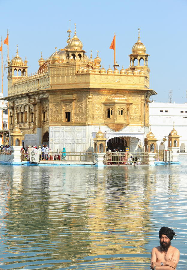 One Sihk Man Washing his Body in the golden temple. royalty free stock photos