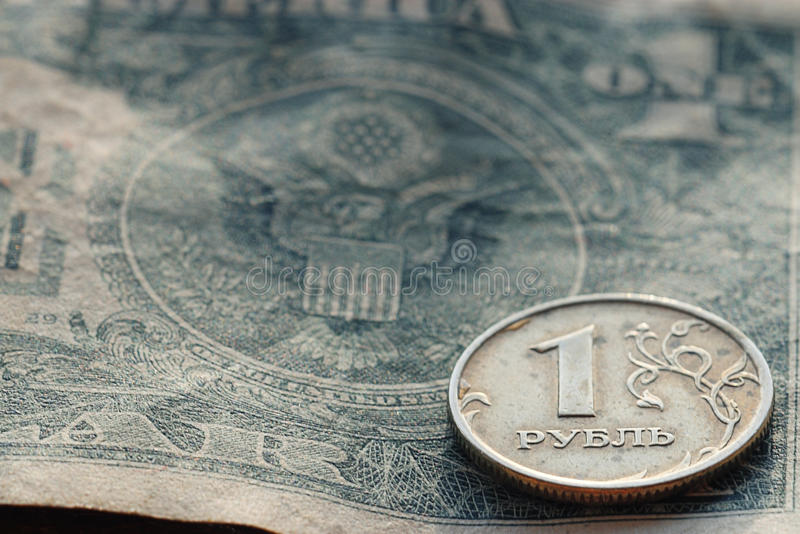 One silver ruble coin. On dollar bill royalty free stock photography