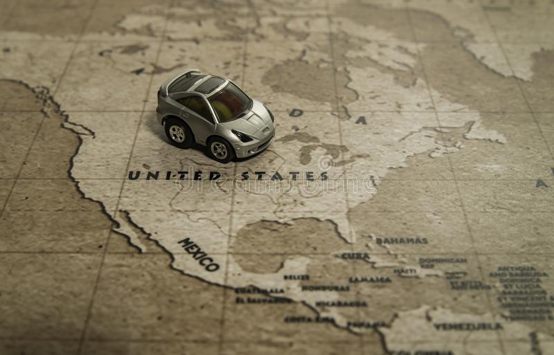 One toy car park on United states country in world map. One silver toy car park on United states country in the retro world map royalty free stock images