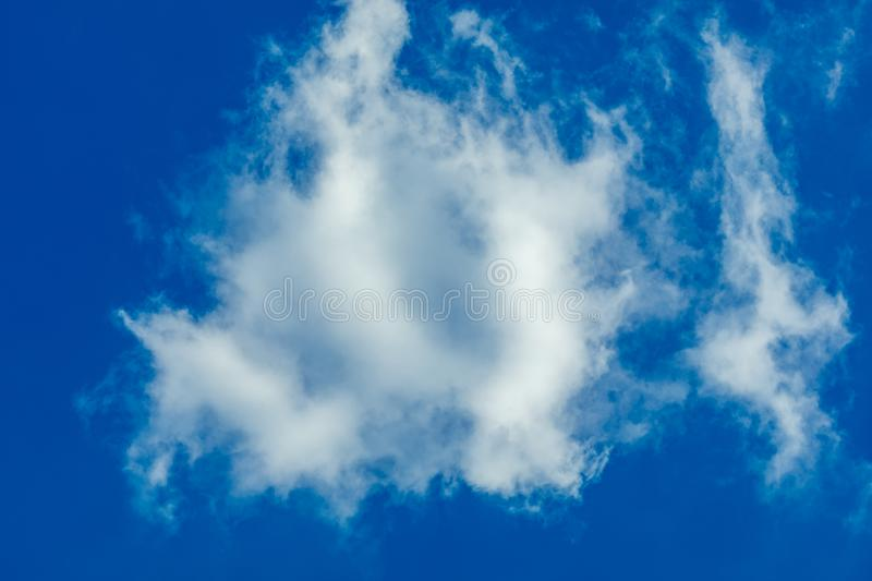 One simple cloud. On sky in summer sunny day clean concept royalty free stock image