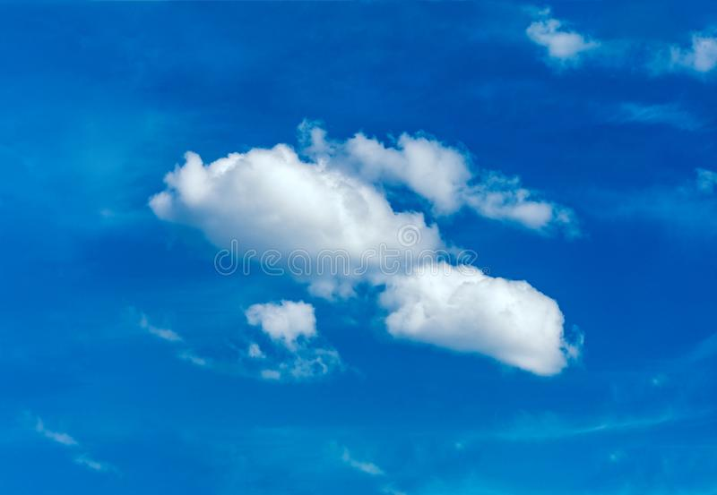 One simple cloud. On sky in summer sunny day clean concept stock photo