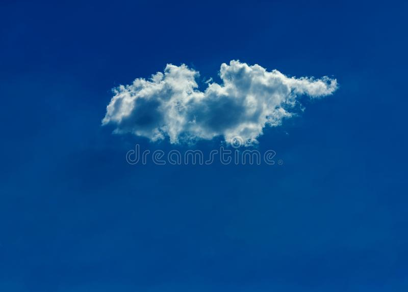 One simple cloud. On sky in summer sunny day clean concept royalty free stock photos