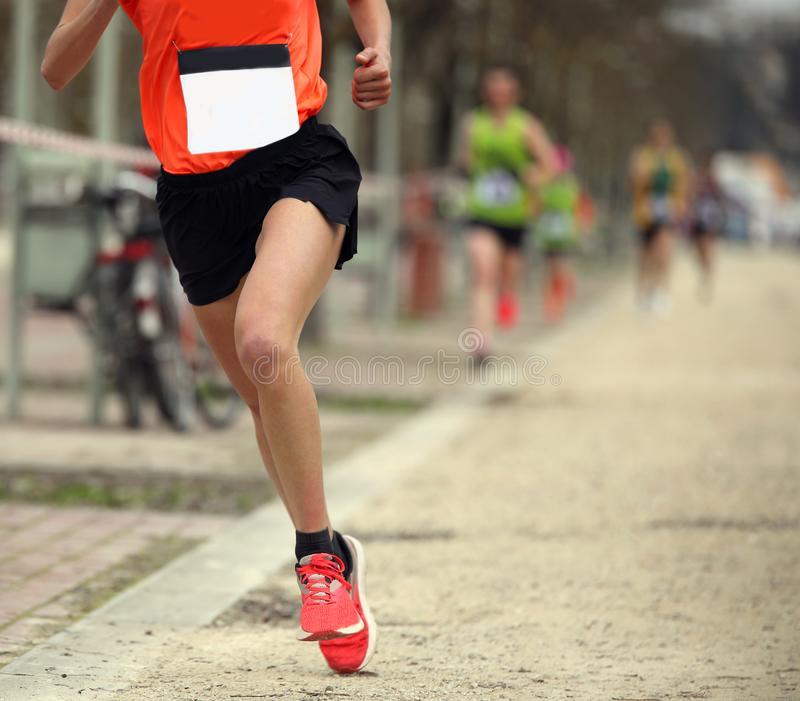 One single runner during a crosscountry race. One single runner during a crosscountry footrace stock photos