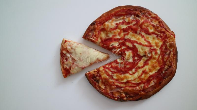 one slice of pizza or a whole stock photos