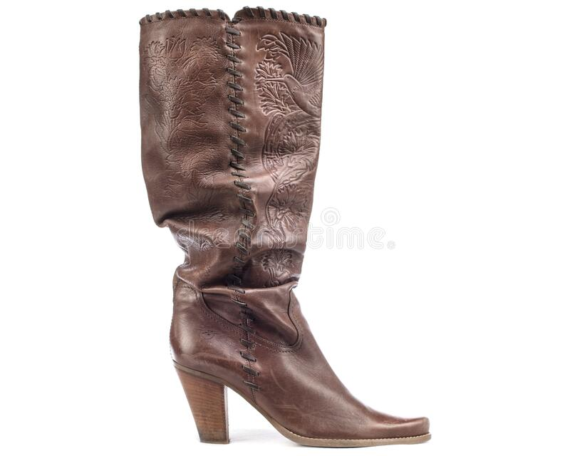 One Slouch Western Boots 90s. Vintage Cowboy Waxed Leather Heeled Tall Pointed Boots Tooled Brown Pull On Southwest royalty free stock images