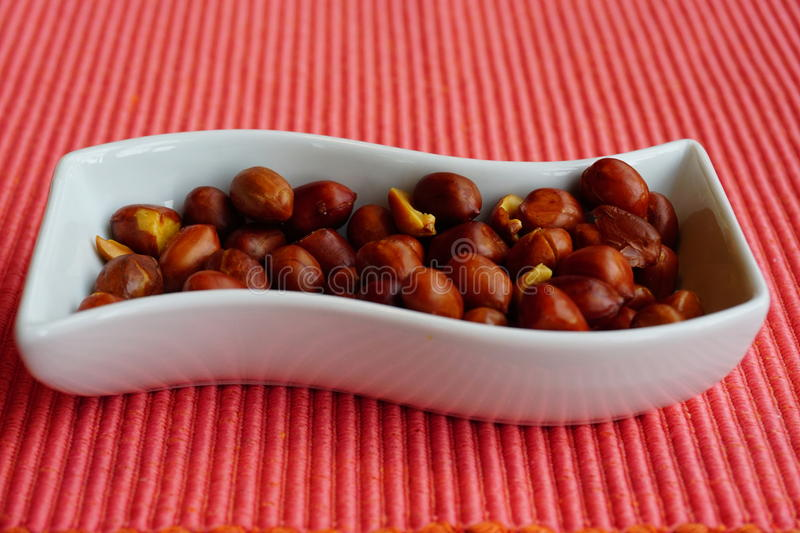 One small cup of peanuts stock images