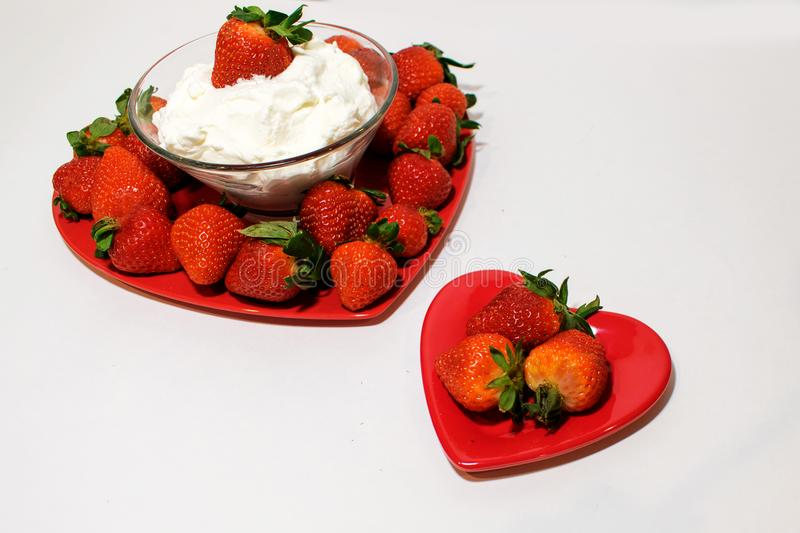 One small and one large heart plate with strawberries stock photo