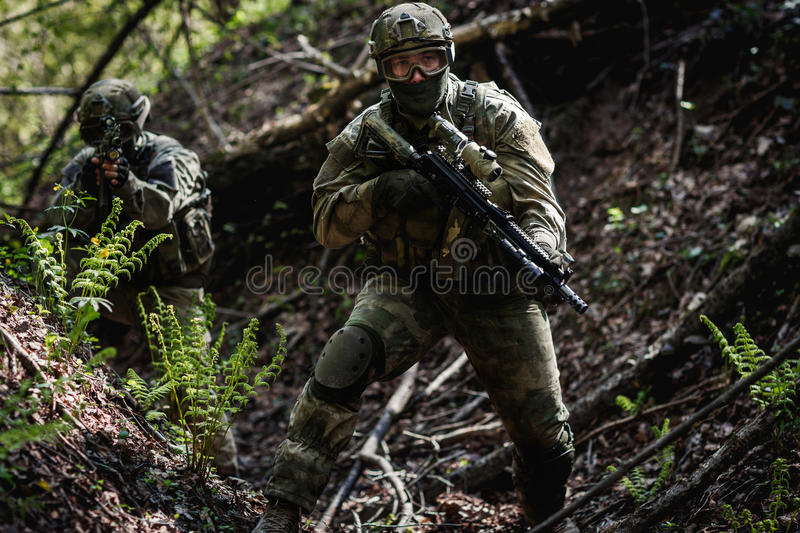 One soldier on military mission. One soldier among trees on military mission during day stock images