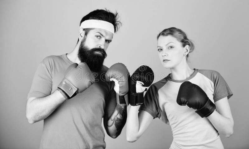 One spirit, one team, one win. punching, sport Success. sportswear. Fight. training with coach. Happy woman and bearded. One spirit, one team, one win. punching royalty free stock photo