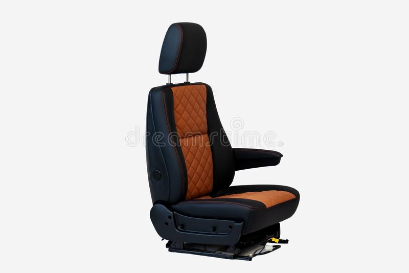 One sport seat of van with armrest with black and brown leather trim, located on the white isolated in the workshop for repair and. Tuning of cars and vehicles stock photo