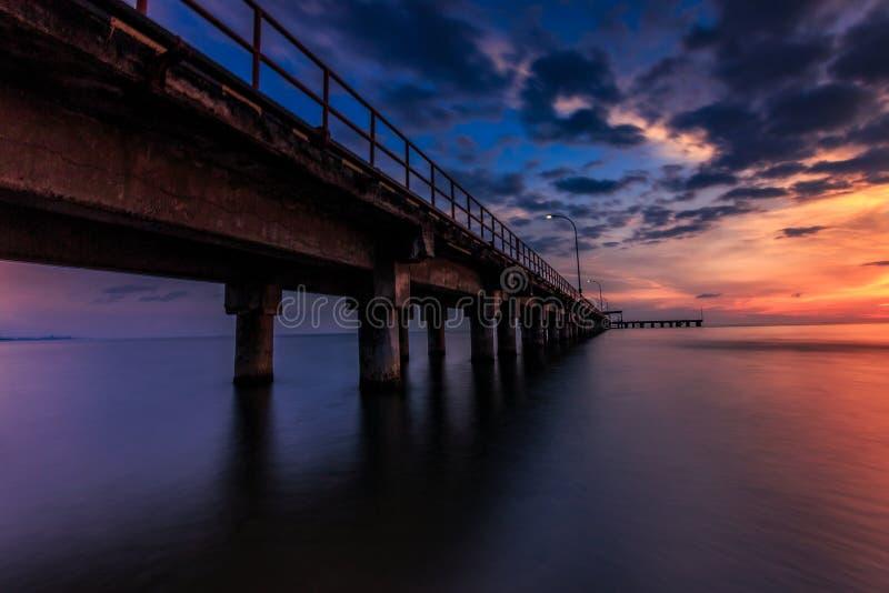 Sunset at barombong pier Makassar royalty free stock images