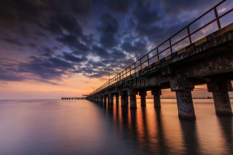 Sunset at barombong pier Makassar stock photography