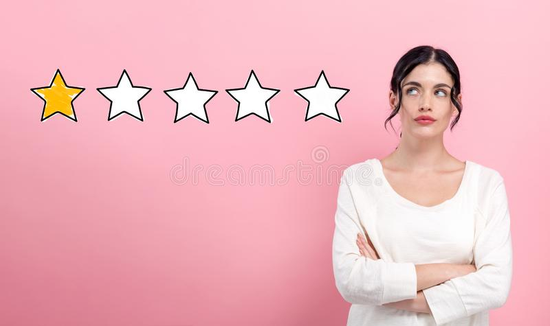 One star rating with young woman royalty free stock photography