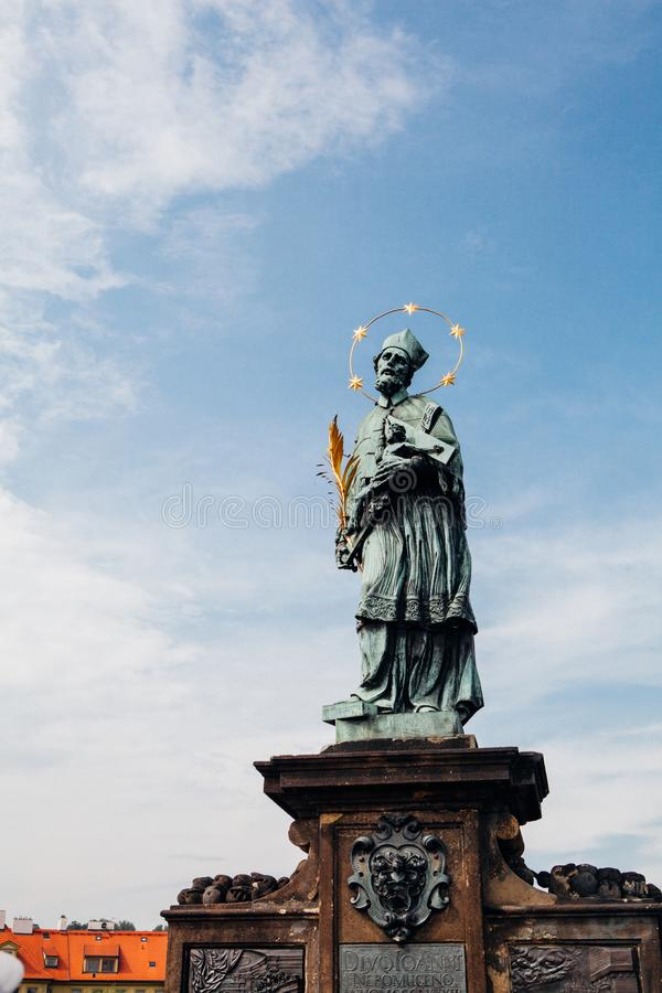 Statue on Charles Bridge in Prague stock image