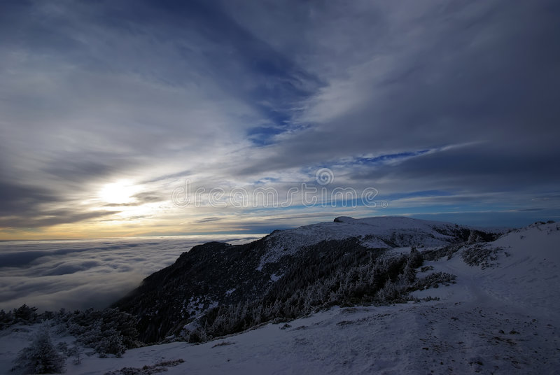 One step too far. The Ocolasu peak (1907 m.) at sunrise, Carpathian mountains stock images