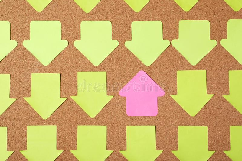 One sticky note standing out from others on cork background, top view royalty free stock image