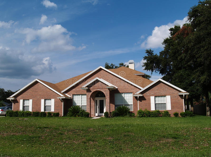 One Story Brick Residential Home. The exterior of a one story brick residential home royalty free stock photography