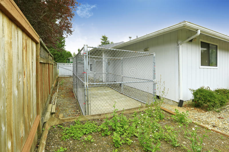 Download One Story House Exterior. Fenced Backyard View With Cage. Stock  Photo   Image