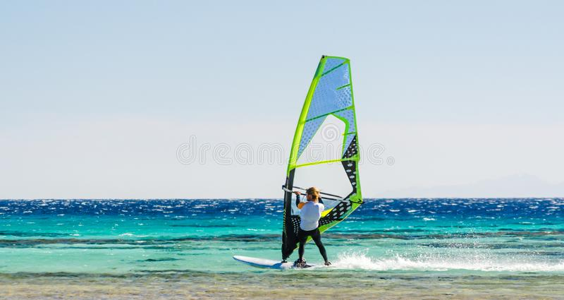 One surfer rides in the Red Sea in Egypt Dahab stock photos