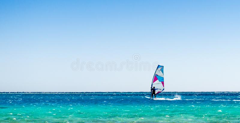 One surfer rides in the Red Sea in Egyp stock photos