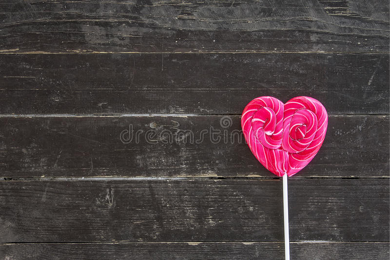 One sweet heart. One sweet rose heart on wooden background royalty free stock photography